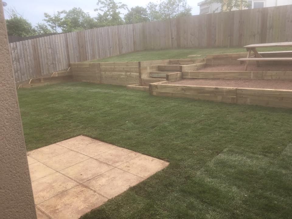 new wooden steps being installed in garden