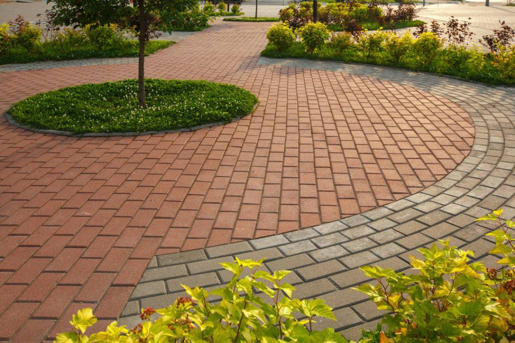 Paved floor and flower beds in a circled patio