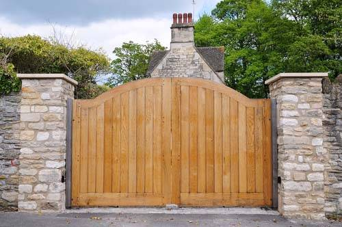 new wooden gate fitted outside house